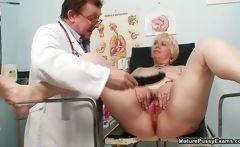 Blonde grandma gets her pussy examed
