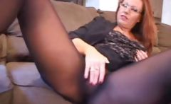Izzy is a mature redhead in black stockings who does some fingering