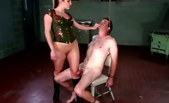 Dominatrix is jerking submissives cock