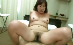 Oriental tramp gets her hairy pussy rocked on bed